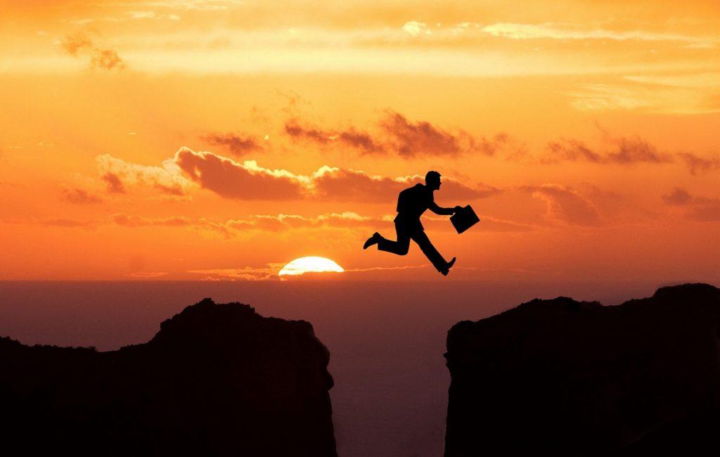Man jumping beyond border
