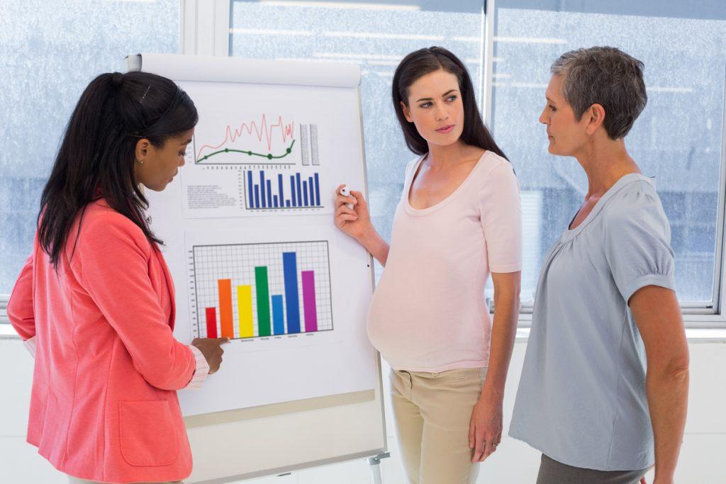 Pregnant businesswoman making a presentation at work