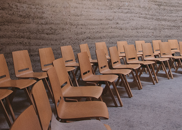 brown wooden chairs in a room