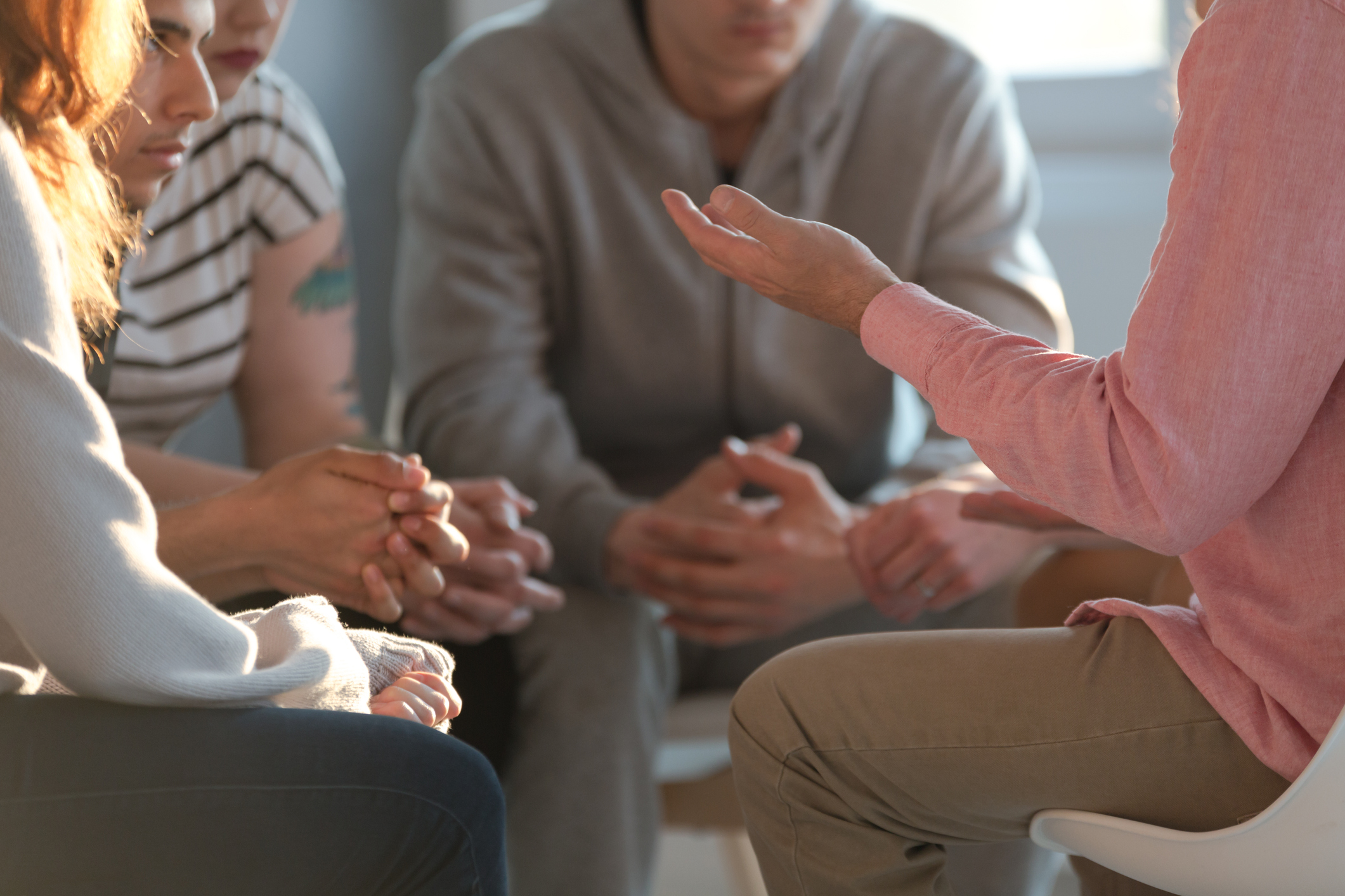 people talking in circle during group therapy