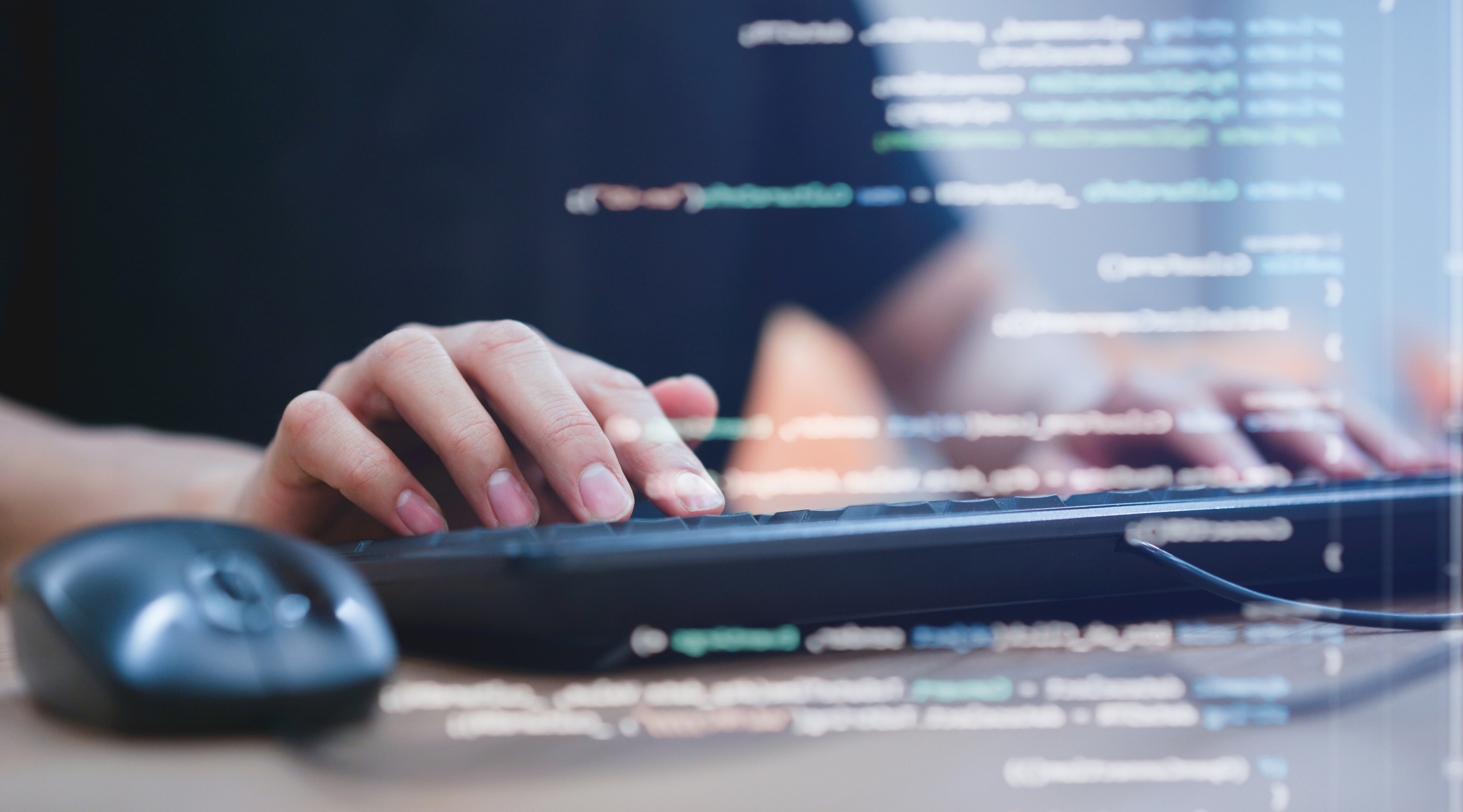 hands typing on keyboard with code overlaid over top image