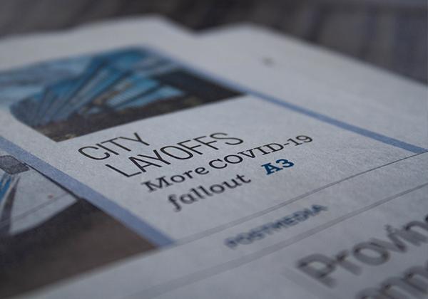 newspaper with covid-19 headlines