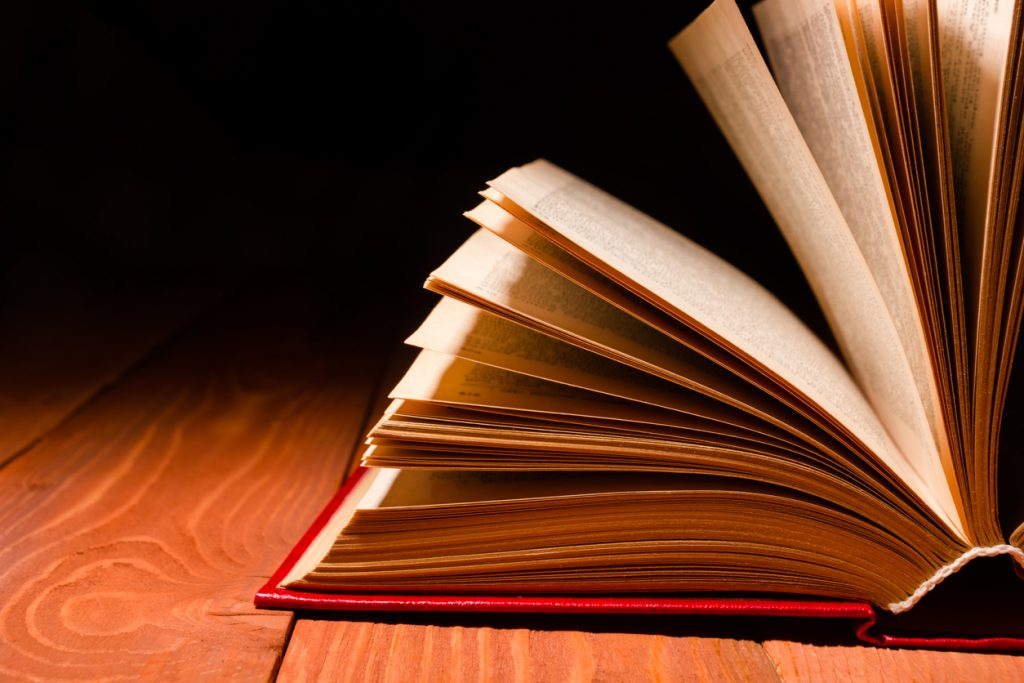 book fanned out on hardwood