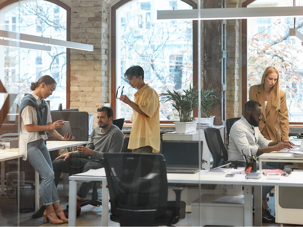 diverse group of young people working in modern office