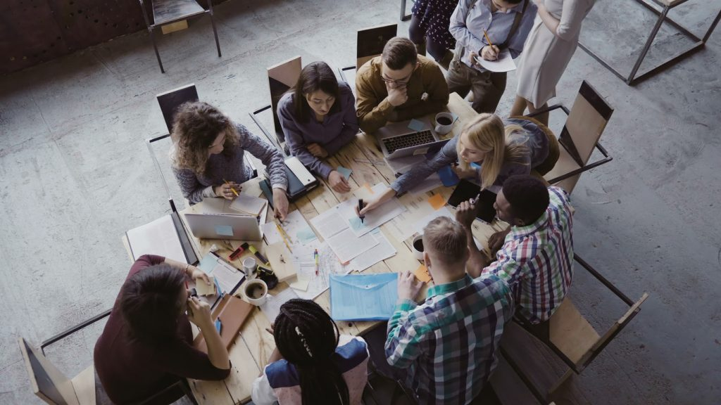 diverse group of people having meeting in industrial-style office