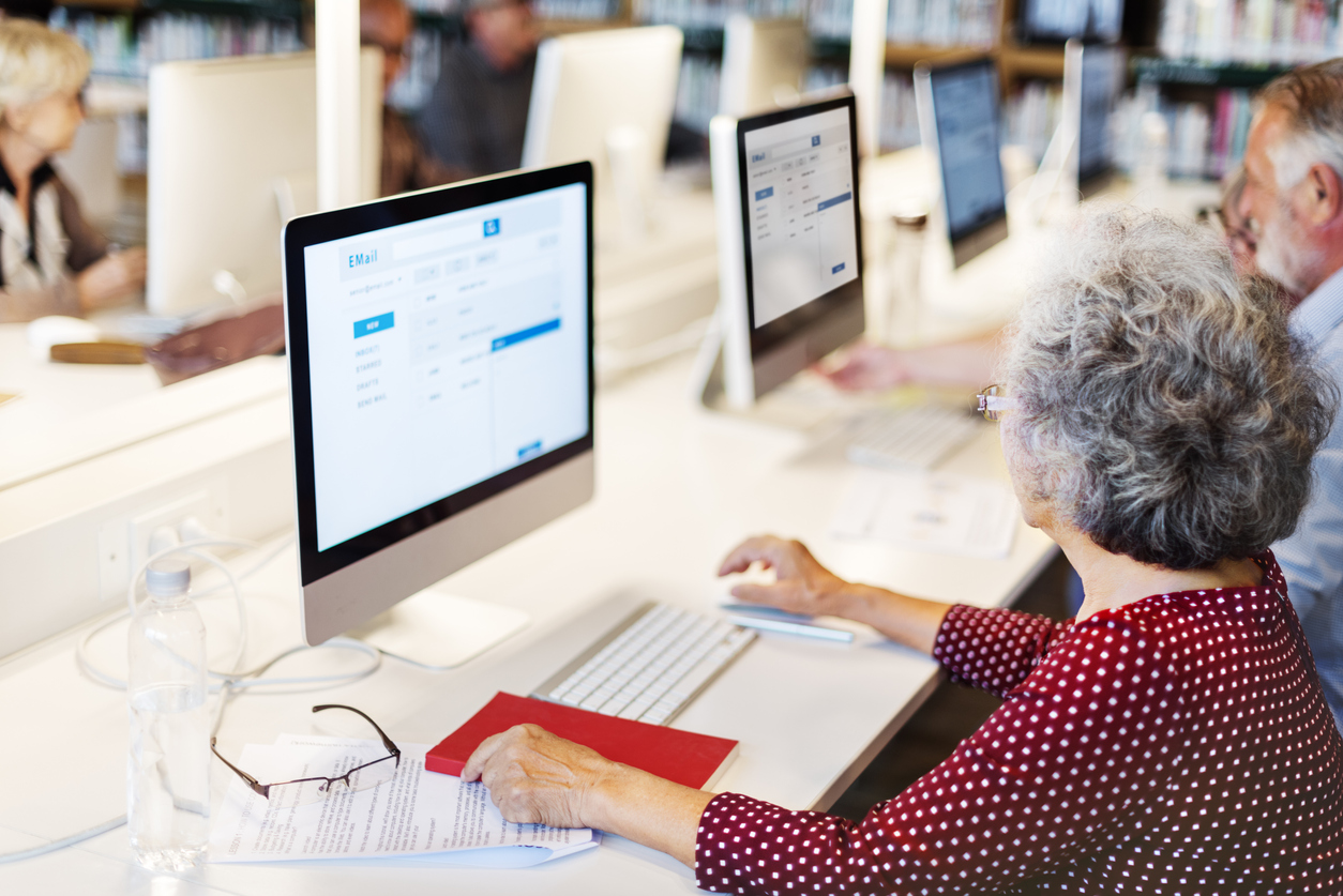 older woman using computer in computer lab