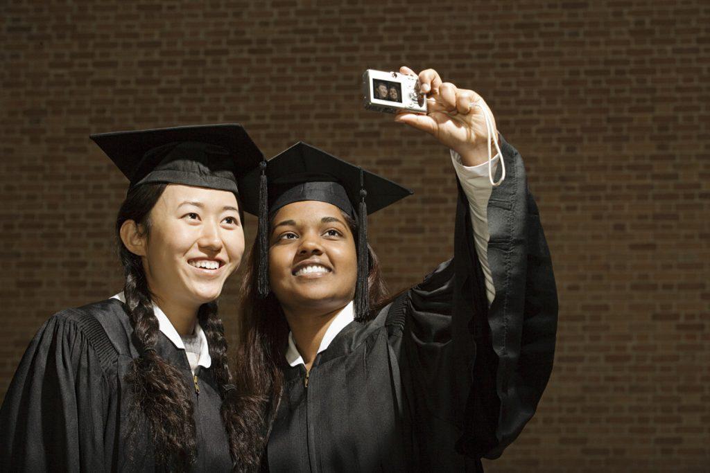Two female graduates taking a selfie