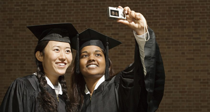 Two female graduates taking a selfie