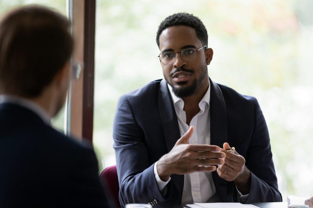 two businessmen talking in office