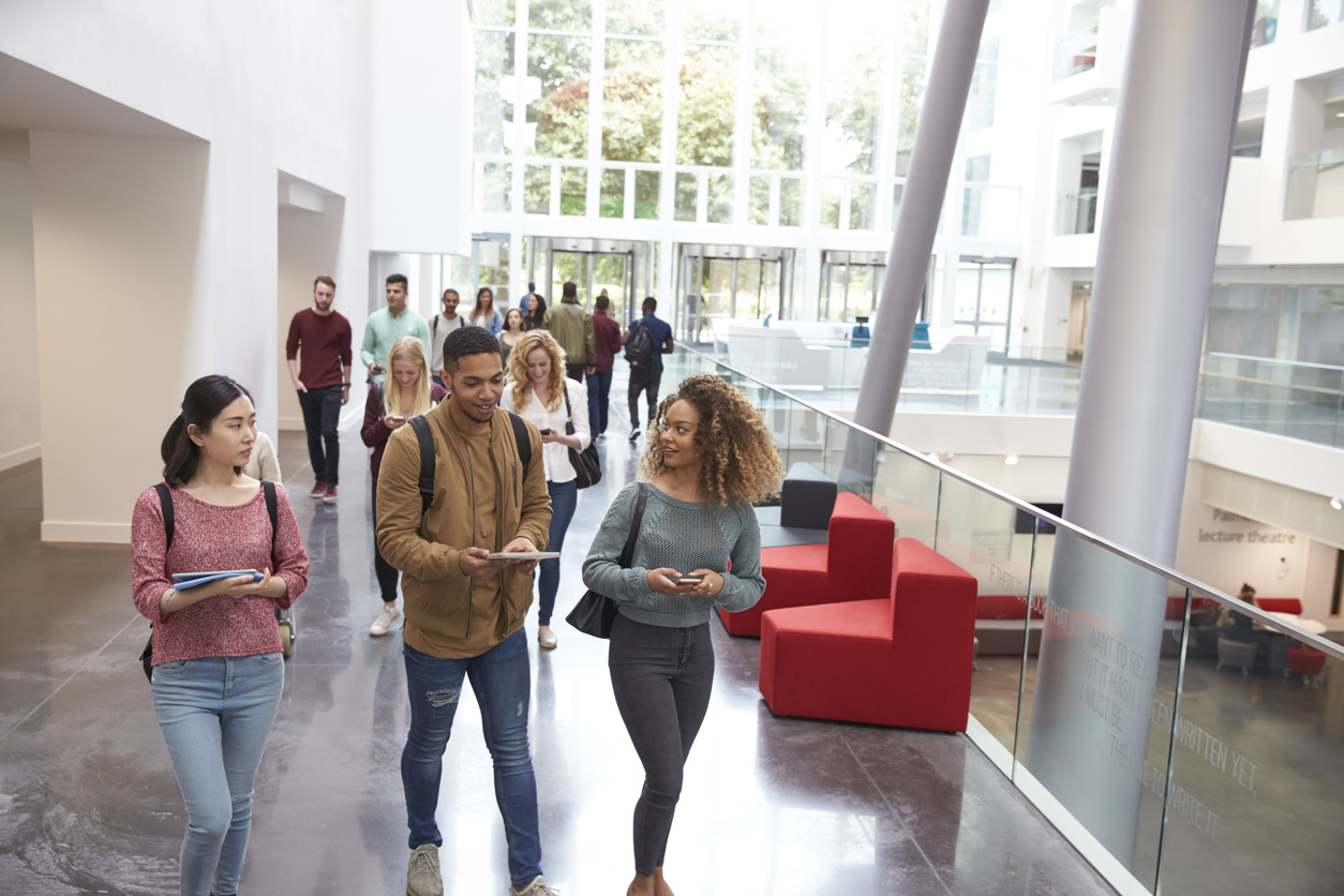 students walking and talking in university