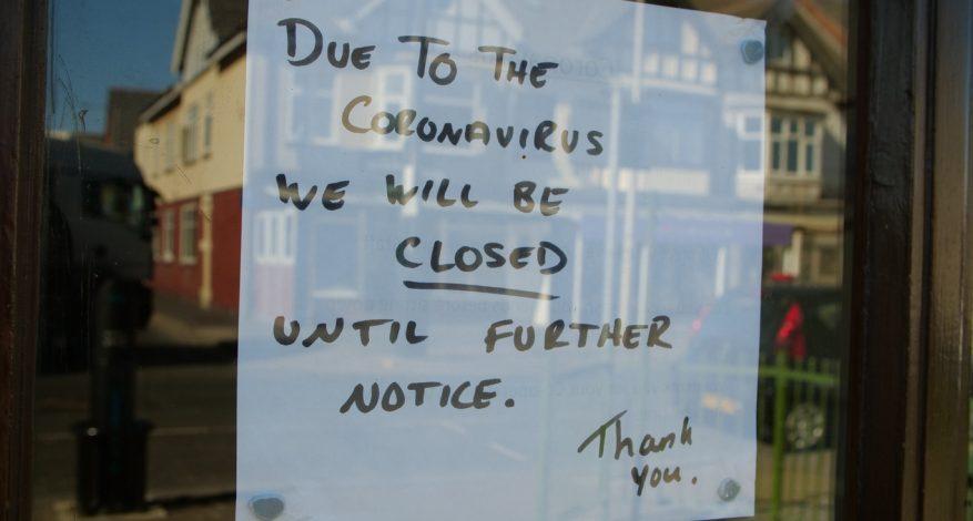 closed due to coronavirus sign on business door