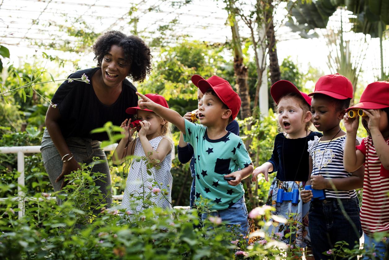 Teacher and kids school learning ecology gardening