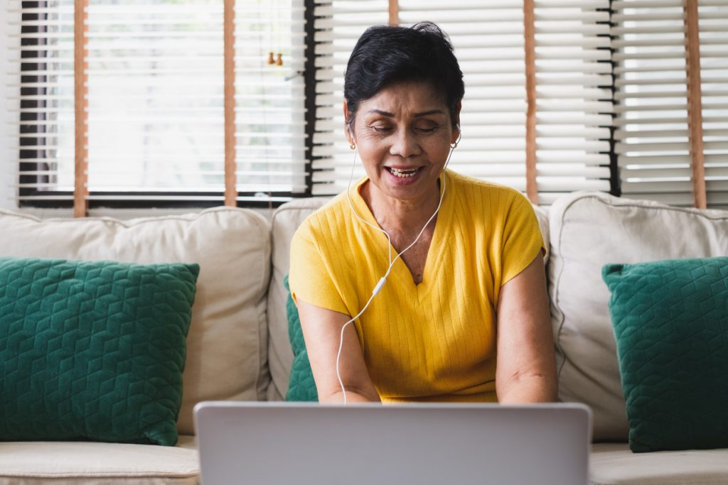 Woman on video call on laptop.