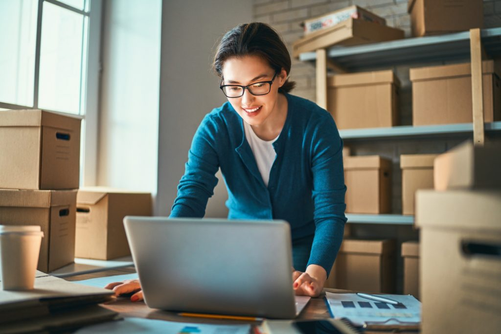 Woman is working at warehouse for online seller